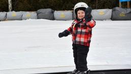 little boy skier on magic carpet