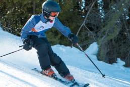 Ski racer going down the hill