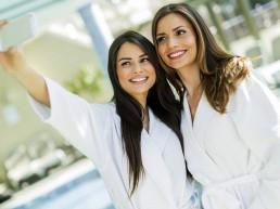 2 girls taking a selfie