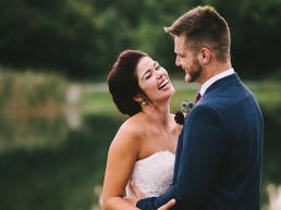 Bride and groom in front of the pond