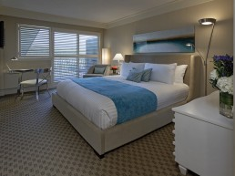 resort room with a bed and dresser and desk