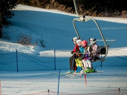 Chairlift with 4 skiers