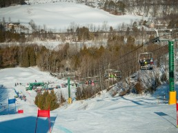 Chairlift with skiers