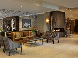 Resort lobby with couches and fireplace