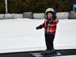 little boy on a ski magic carpet
