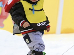 little boy on a riglet