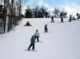 snowboarders on the ski hill